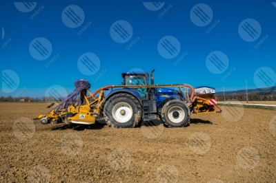 umbria agriculture field tractor work countryside sky clear sky