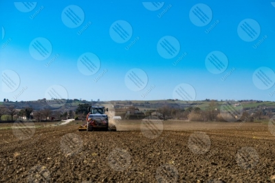 umbria agriculture field tractor work countryside sky clear sky panorama