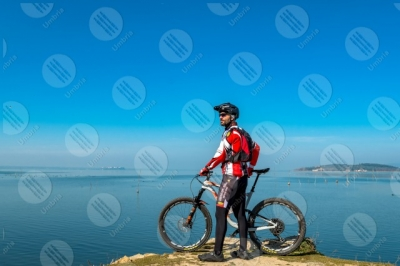 trasimeno Trasimeno Lake bike bicycle cyclist Polvese Island shore pathway water sky clear sky panorama view landscape man