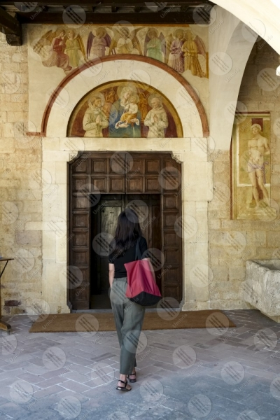 montefalco Convento di San Fortunato face entrance columns paintings womang girl