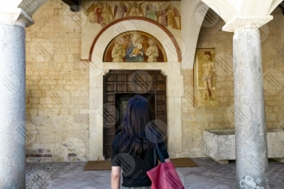 montefalco Convento di San Fortunato face entrance columns paintings woman girl