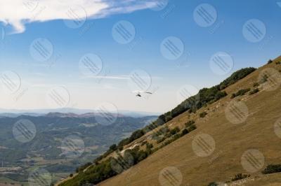 eugubino-altochiascio park Monte Cucco hang glider sport fly view landscape hills mountains sky